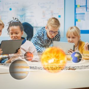 Group of School Children in Science Class Use Digital Tablet Computers with Augmented Reality Software, Looking at Educational 3D Animation Of Solar System. VFX, Special Effects Render